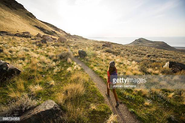 a woman hiking a hilly trail. - salt lake city stock pictures, royalty-free photos & images