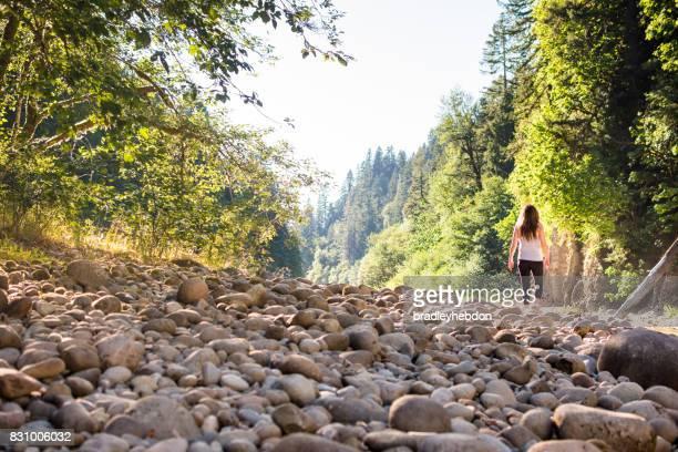 Woman hiking along the banks of an Oregon river