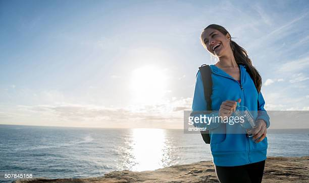 Woman hiking and holding a bottle of water