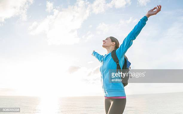 Woman hiking and looking very happy