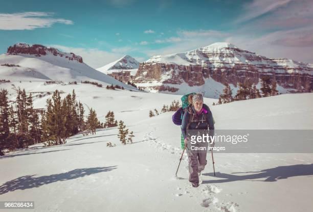 woman hiking at grand teton national park during winter - grand teton national park stock pictures, royalty-free photos & images