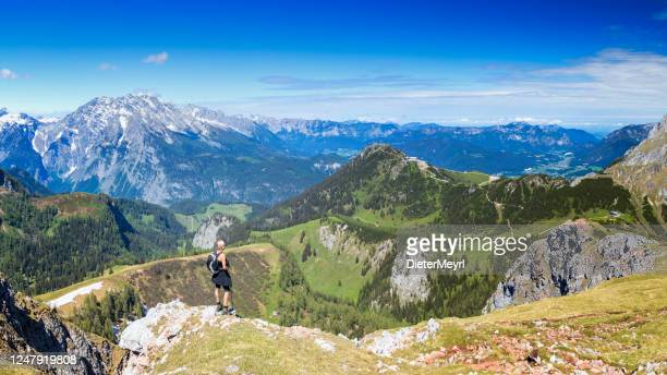 woman hiking, berchtesgaden mountains national park, germany - bavarian alps stock pictures, royalty-free photos & images