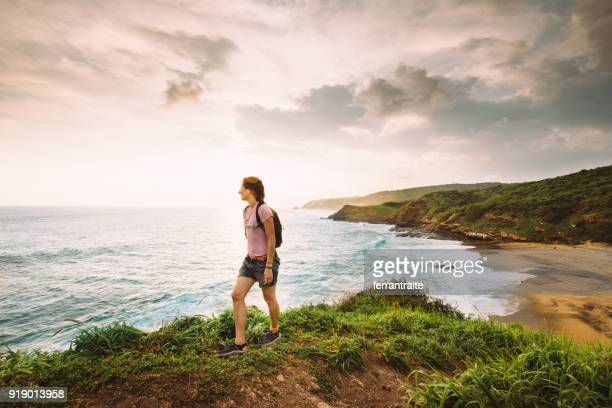 woman hiking by the beach in oaxaca in mexico - oaxaca stock pictures, royalty-free photos & images