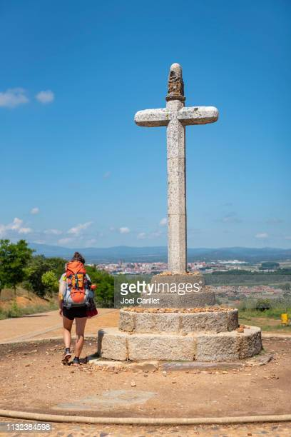 woman hiking camino de santiago above astorga, spain - pilgrimage stock pictures, royalty-free photos & images
