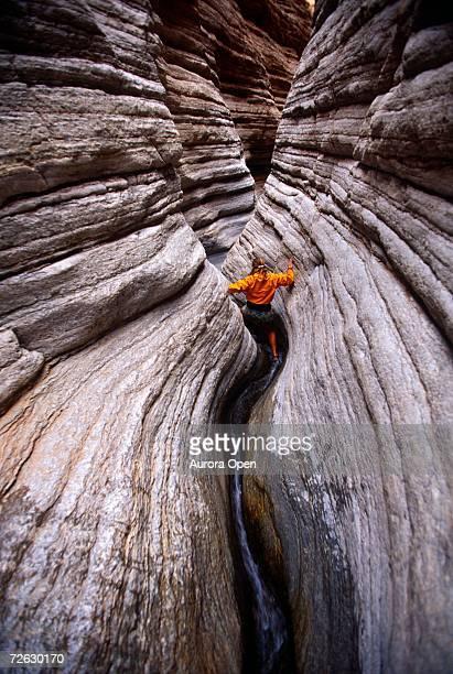 A woman hiking down narrow canyon, Grand Canyon, Arizona.