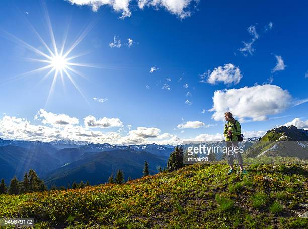 Woman hiking high on ridge