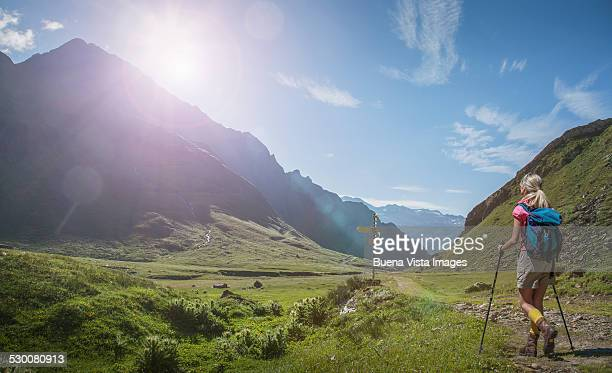 woman hiking in a mountain valley