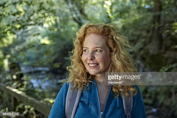 Woman hiking in forest, portrait