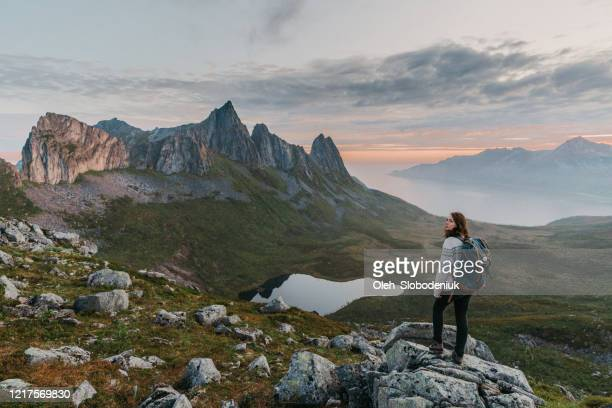 woman hiking  in mountains  on senja mountains in fog - northern norway stock pictures, royalty-free photos & images