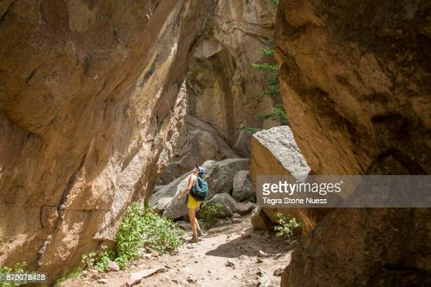 Woman hiking in rocky canyon in Colorado