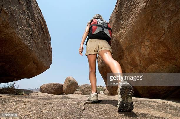 Woman hiking in rocky terrain
