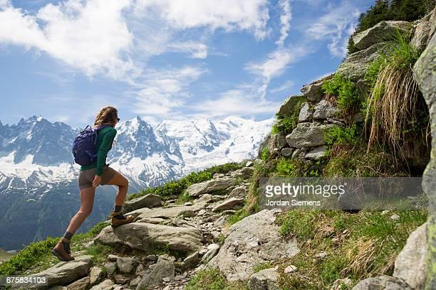 a woman hiking in the mountains. - monte bianco foto e immagini stock