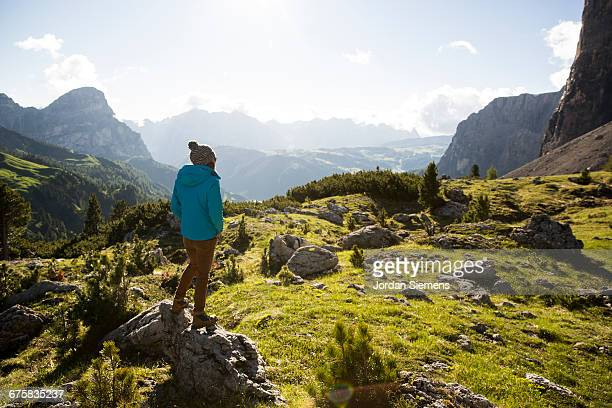 A woman hiking in the mountains.