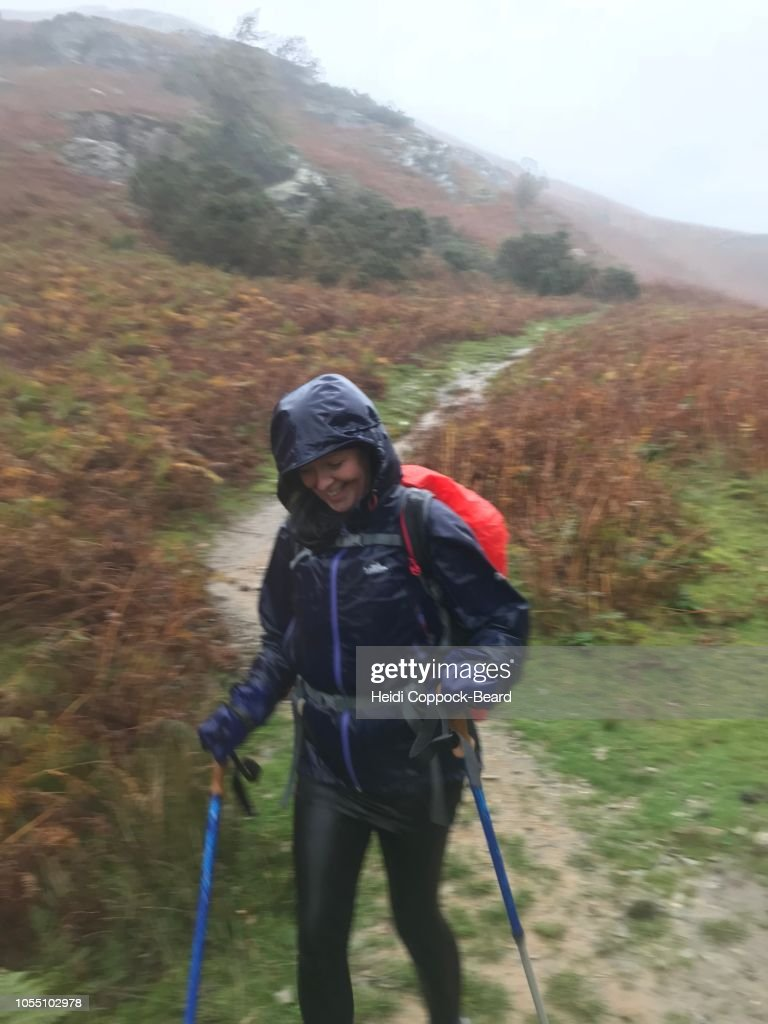 Woman Hiking in the rain : Stock Photo