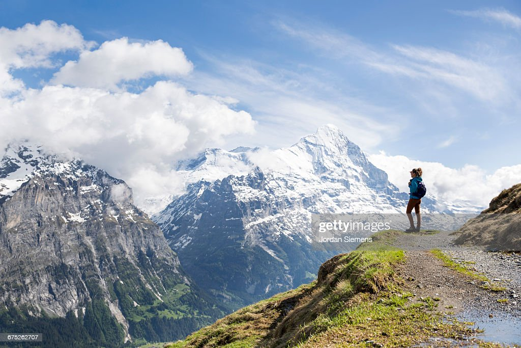 A woman hiking in the Swiss Alps : Stock Photo