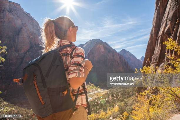 woman hiking in usa taking a rest on top of valley - zion national park stock pictures, royalty-free photos & images