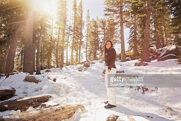 woman hiking in winter forest - ski pants stock pictures, royalty-free photos & images