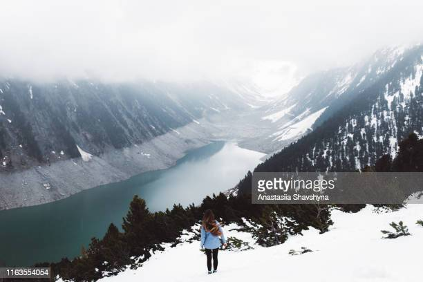 woman hiking in zillertal alps near schlegeis lake during snow - wonderlust stock pictures, royalty-free photos & images