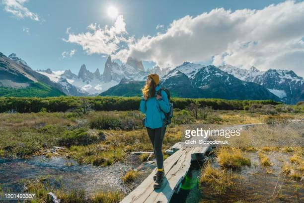 woman hiking near  fitz roy mountain in patagonia - south stock pictures, royalty-free photos & images