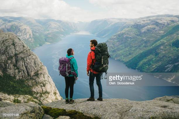Woman hiking near Preikstolen and looking at Lysefjorden
