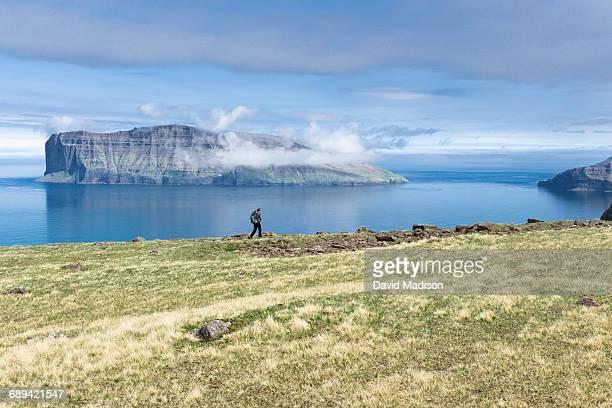 Woman hiking near Vidareidi