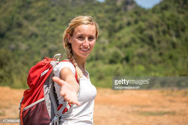 Woman hiking offering to join her