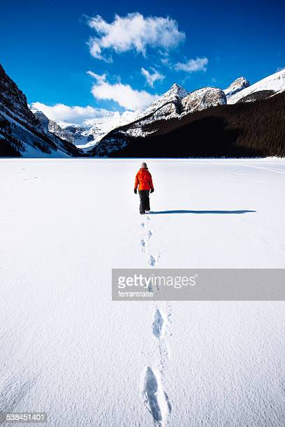 Woman Hiking on Banff National Park in Winter Canada