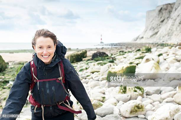 Woman hiking on beach, Beachy Head, Eastbourne, East Sussex, England, UK