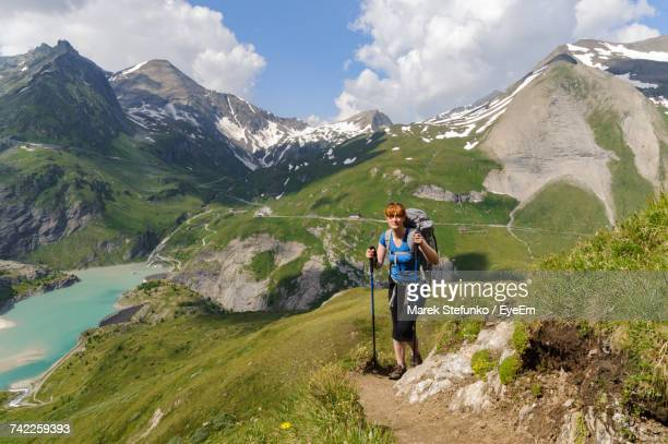 woman hiking on mountain against sky - marek stefunko stock photos and pictures