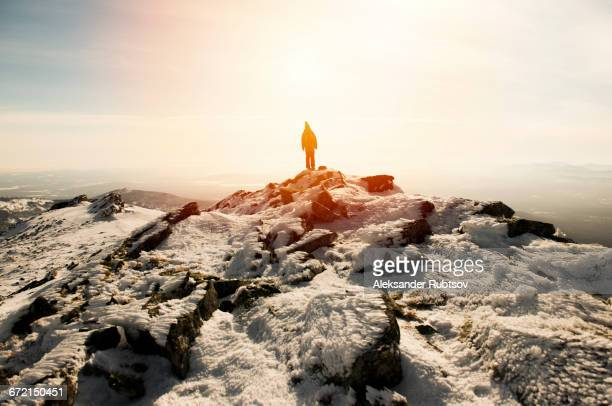 Woman hiking on mountain in winter
