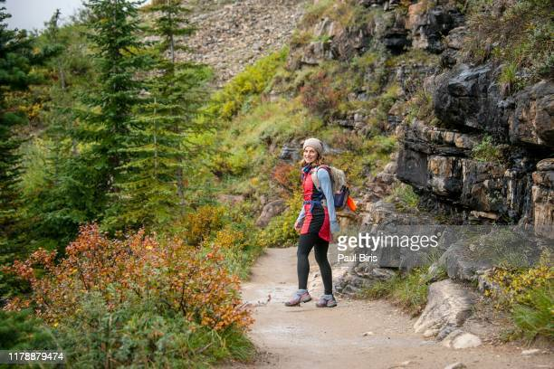 woman hiking on the plain of six glaciers trail in banff national parc, canada - canadian rockies stock pictures, royalty-free photos & images