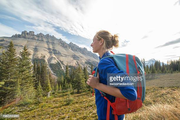 woman hiking on trail stops to admire landscape - canadian rockies stock pictures, royalty-free photos & images