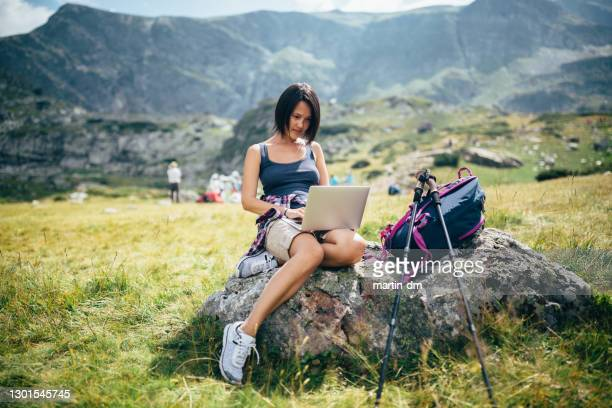 woman hiking - nomadic people stock pictures, royalty-free photos & images