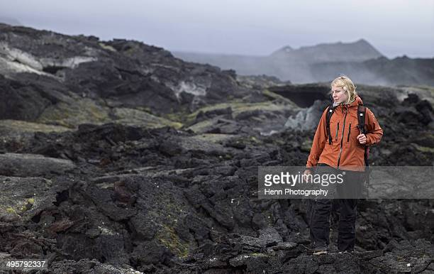 Woman hiking through lava field at the Krafla volcano / north Iceland