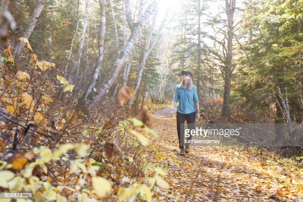 Woman hiking through the forest, South Dakota, America, USA
