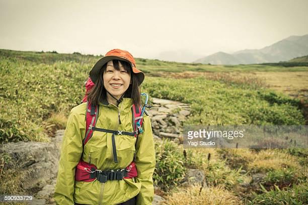 Woman hiking up mountain /Japan Mt.Hakusan
