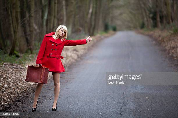 Woman hitch hiking in woods