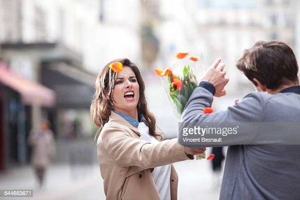 woman hitting a man with a bouquet of flowers - paris fury stock pictures, royalty-free photos & images