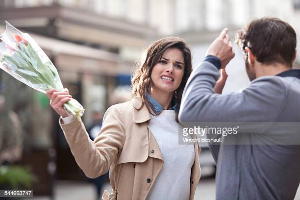 woman hitting a man with a bouquet of flowers - france strike stock pictures, royalty-free photos & images