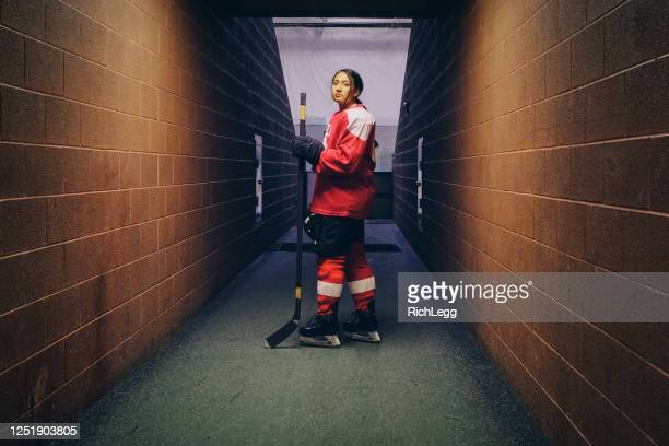 woman hockey player - ice hockey uniform stock pictures, royalty-free photos & images