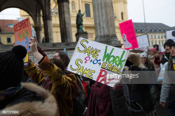 Woman hold a banner for equal pay during the women's march against against USpresident Donald Trump's sexism in Munich Germany on 20 January 2018