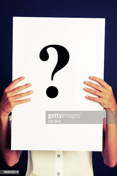 woman holdind question mark sign in front of face - announcement message stock pictures, royalty-free photos & images