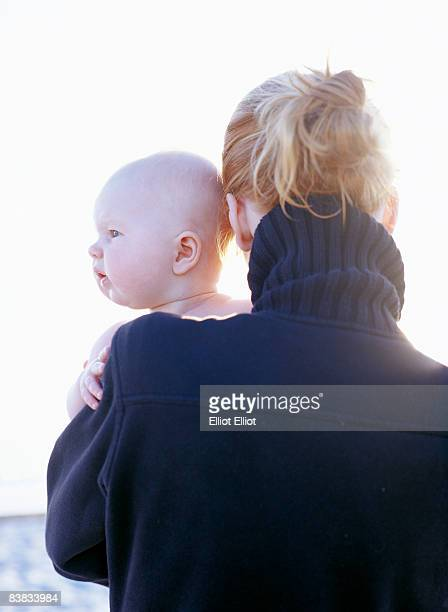 A woman holding a baby Skanor Sweden.