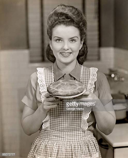 Woman holding a baked pie
