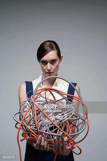 Woman holding a ball of cables