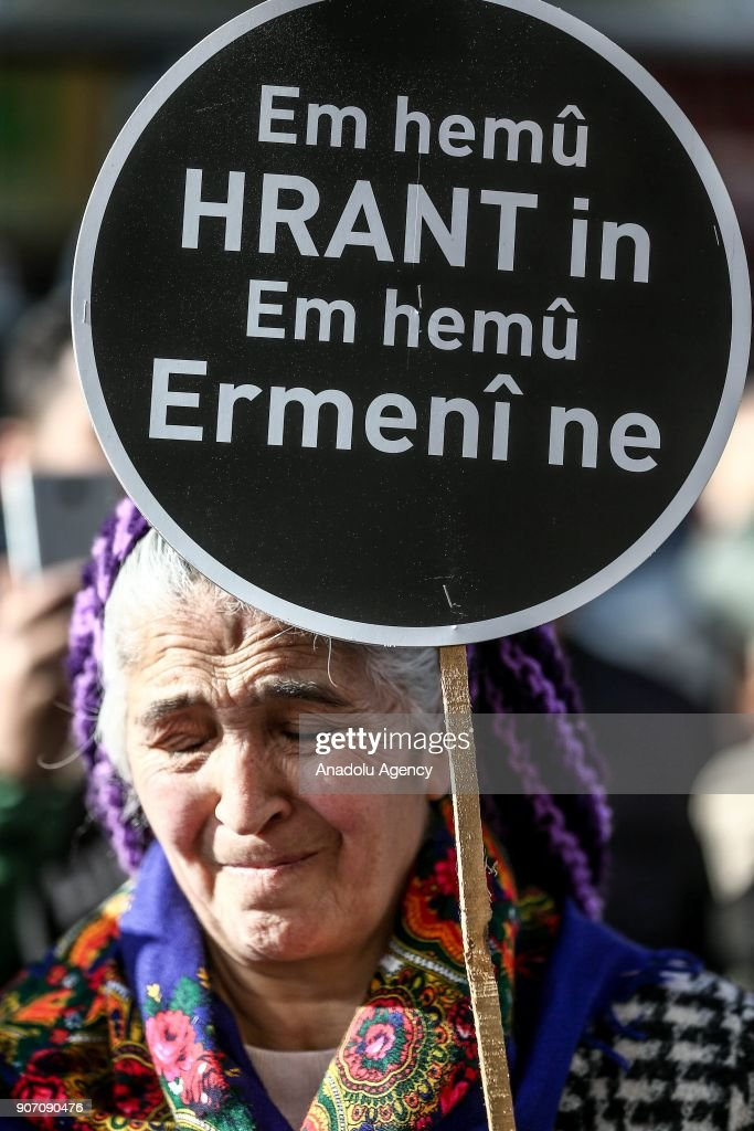 A woman holding a banner cries during a commemoration ceremony in front of Agos newspaper building on the 11th death anniversary of Hrant Dink, former editor-in-chief of the bilingual Turkish-Armenian newspaper Agos, in Istanbul, Turkey on January 19, 2018. He was assassinated in Istanbul in 2007.