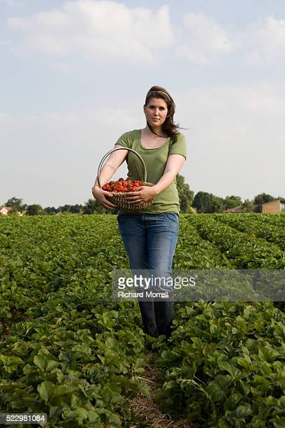 Woman holding a basket of strawberries