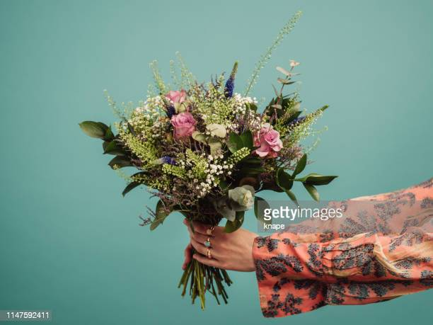 woman holding a big bouquet of flowers - bouquet stock pictures, royalty-free photos & images