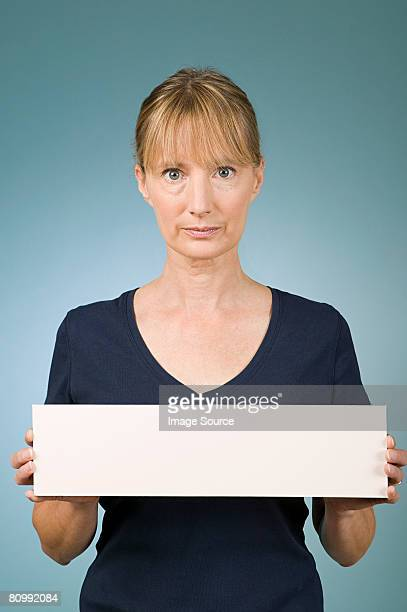 woman holding a blank sign - person holding blank sign stock pictures, royalty-free photos & images