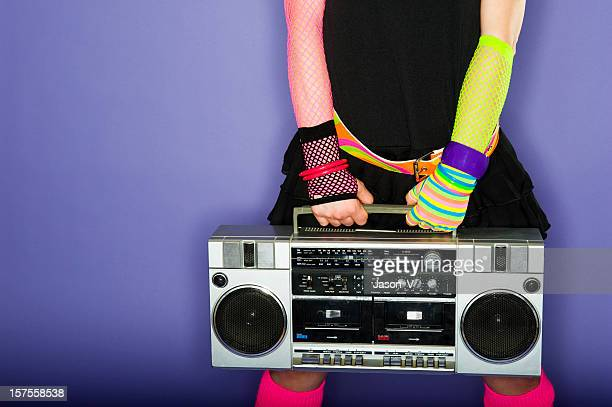 Woman holding a boom box